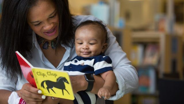 Mother reads a Best Books for Babies book to a baby boy