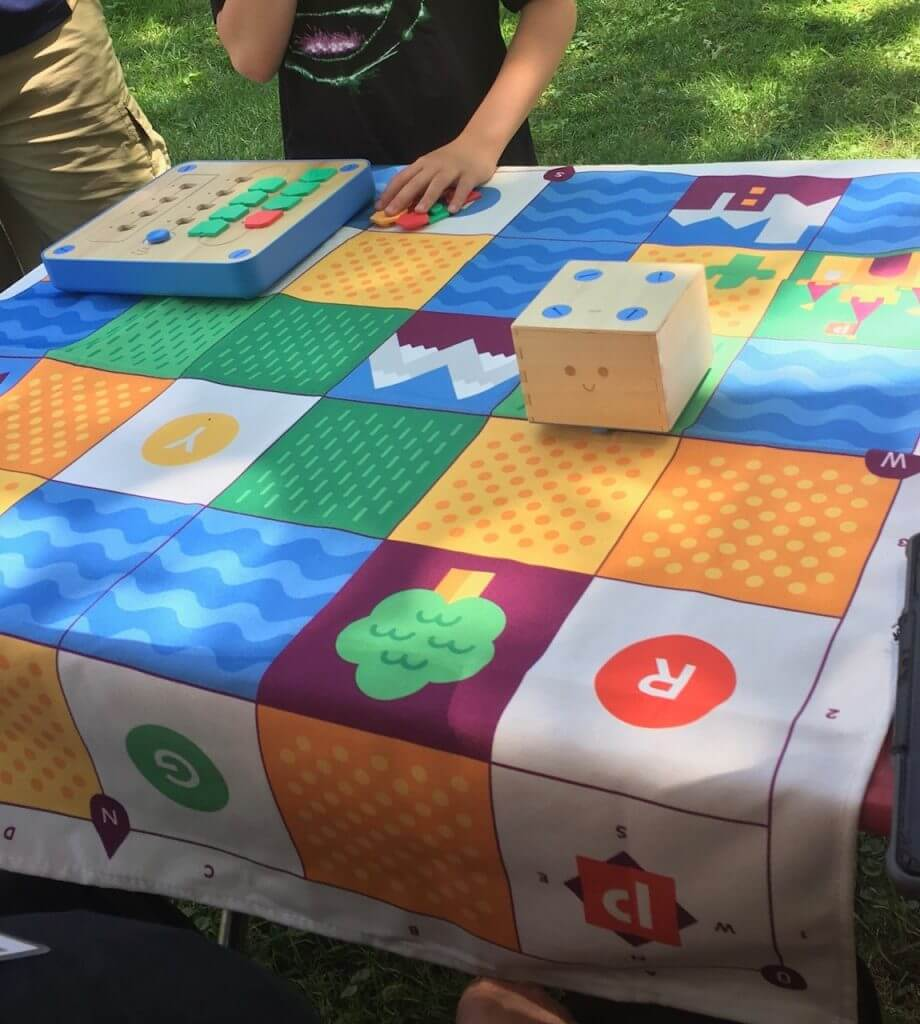 Kids try out Cubetto.