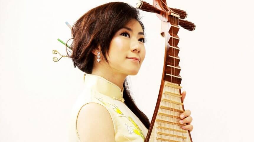portrait of pipa musician Yang Jin. A woman stands holding a Chinese lute.