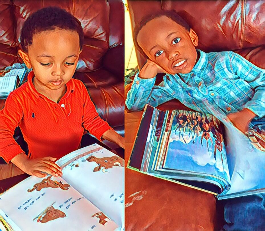 Two young boys enjoy their books.