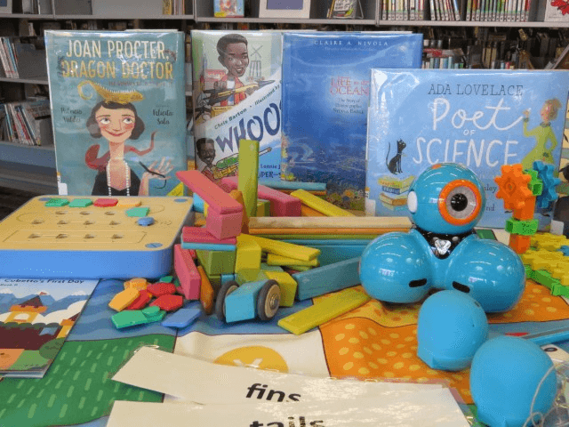A display of books and robots.