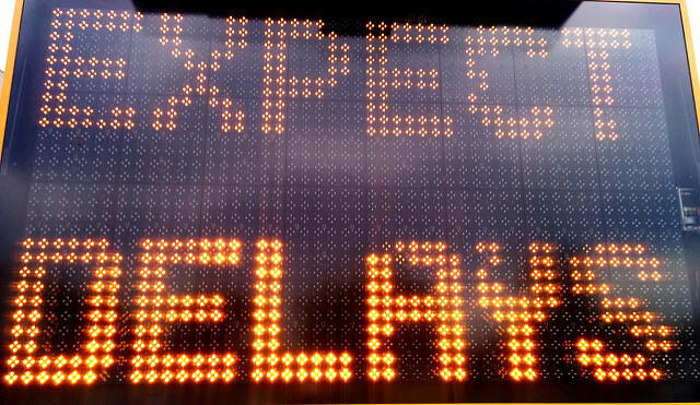 """photo of digital traffic warning sign reading """"EXPECT DELAYS"""""""