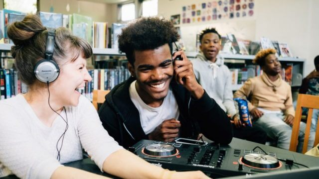 Teen librarian and teen use recording equipment