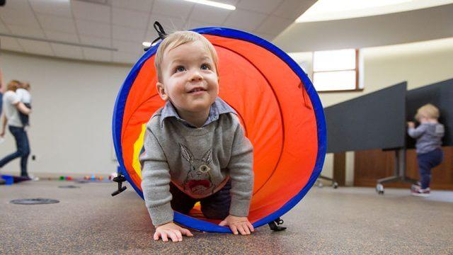 Toddler crawls through tunnel