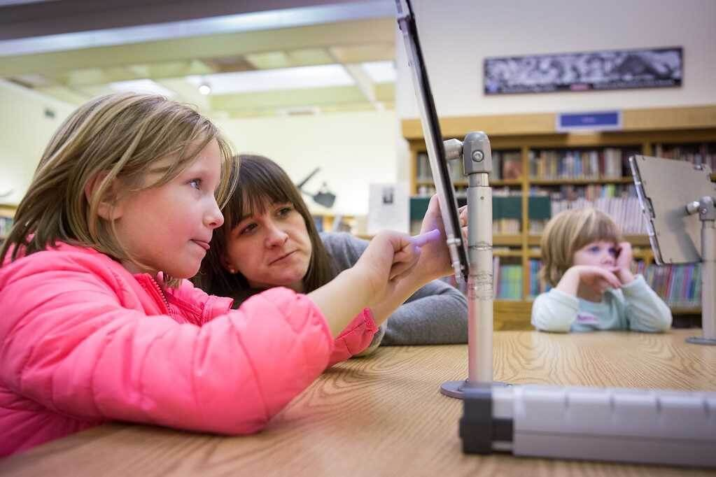 Exploring digital media together during a Reading Buddies program.