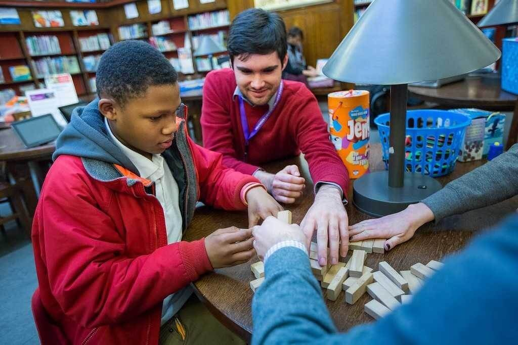 Playing a game of Jenga during a Reading Buddies program.