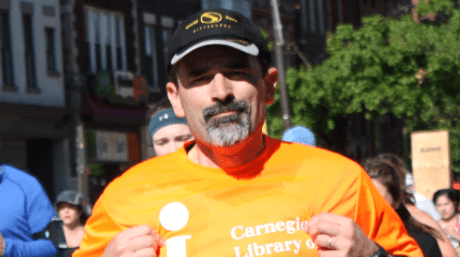 Marathon runner with a Carnegie Library of Pittsburgh shirt