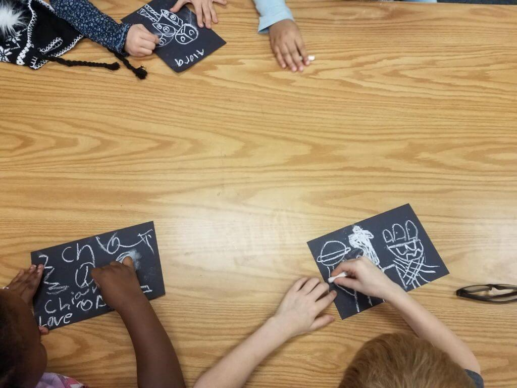Students work on Keith Haring inspired chalk art.