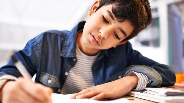 Image of a young boy doing his homework