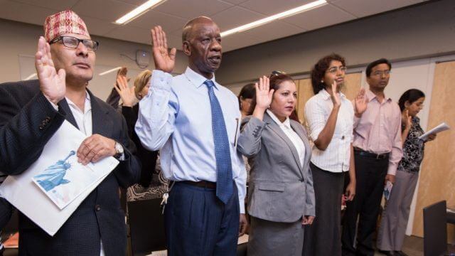 Several new citizens participate in the Naturalization Ceremony.