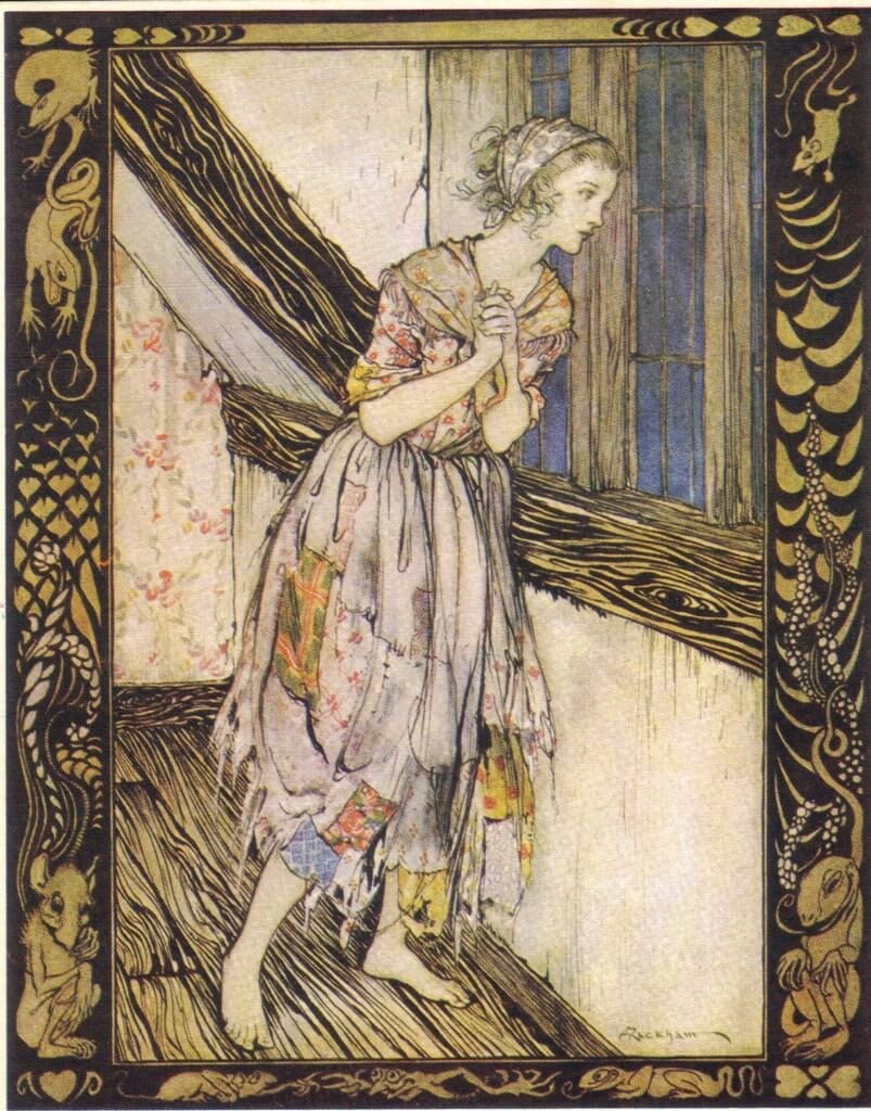 Cinderella stares longingly out of a window dressed in a raggedy patch-work dress.