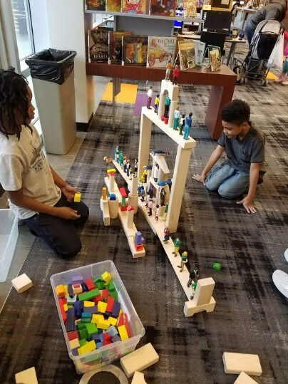 Children play with building materials at the Library.