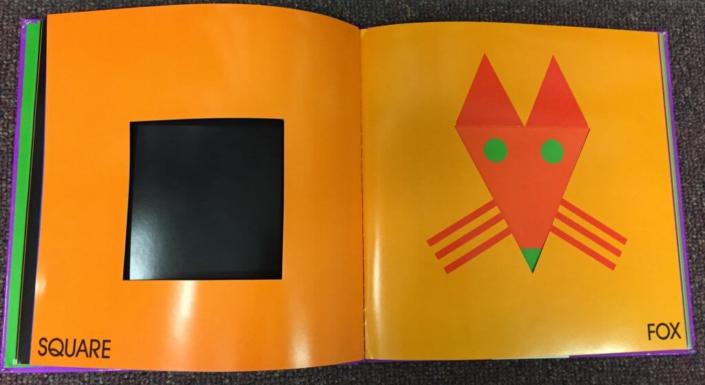 Two-page spread from Color Zoo by Lois Ehlert. Verso page is bright orange with a square cut out of the center, allowing the viewer to see through to the last page, which is solid black.