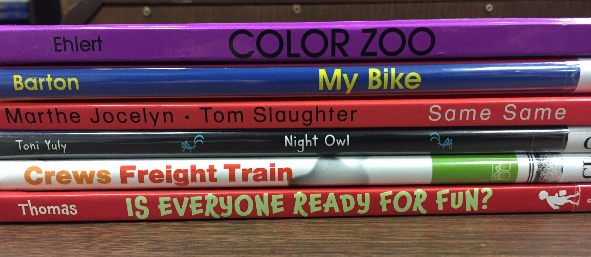 Stack of picture books with titles visible along spines.