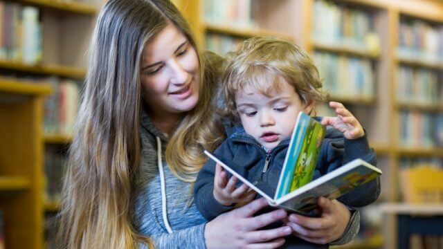 parent reads book to toddler