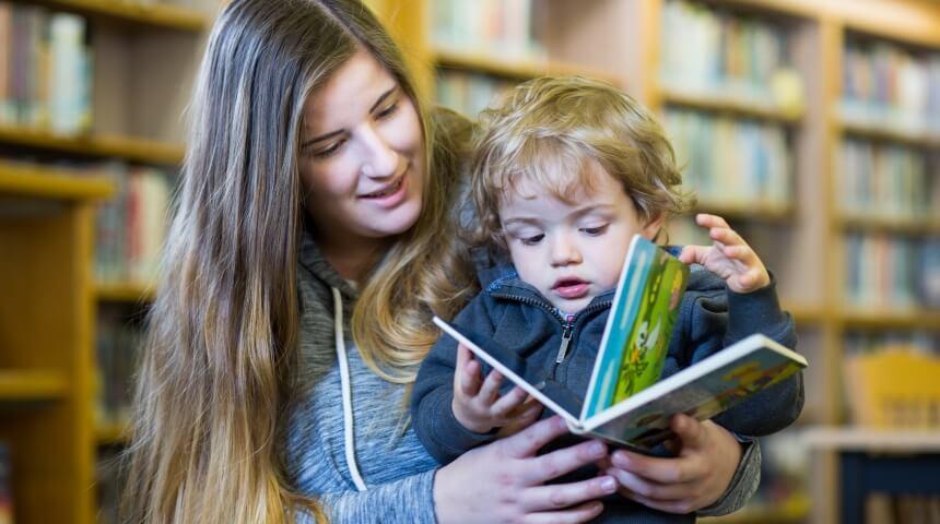 parent reads book to toddler