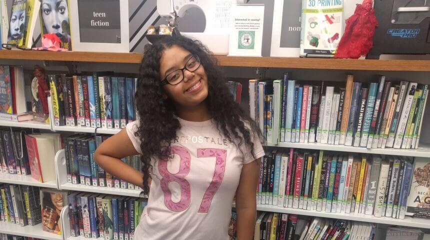 CLP's top teen reader from Summer Reading 2018 stands in CLP-Beechview's Teenspace.