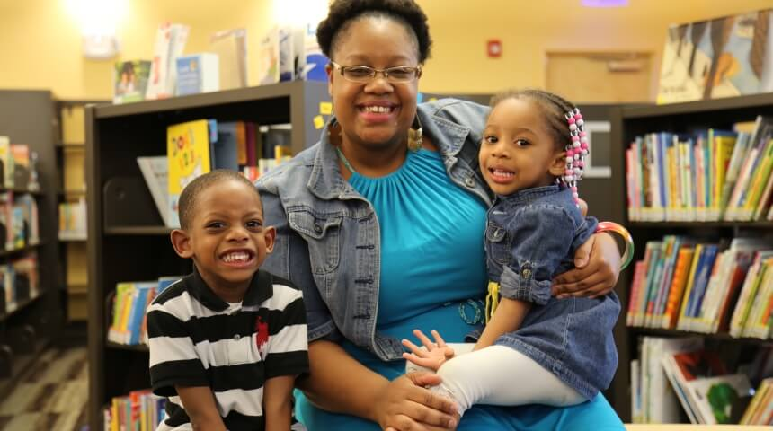 Parent posing with two young children at CLP-Hazelwood.