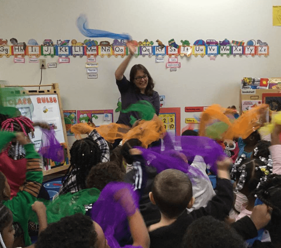 Miss Ellen and children wave their scarves during a storytime at CLP - Hazelwood.