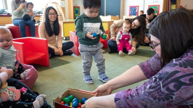 Infants, toddlers and caregivers enjoy a lively storytime
