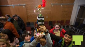 A group of teen Battle of the Books winners hold up their trophy.