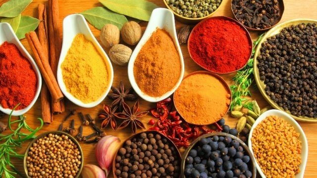 A colorful palette of Indian spices and herbs