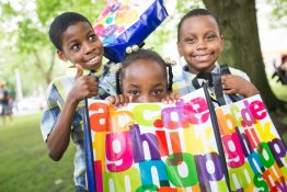 Kids posing with their summer reading bags