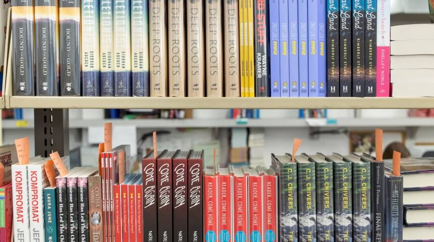 New book arrivals on shelves at the CLP West End Distribution Center.