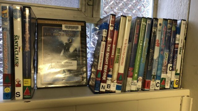 Collection of holiday-themed library DVDs.