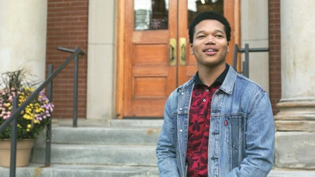 2018 Teen Advocate of the Year Jeremiah Fielder stands on the front steps of the CLP - West End library
