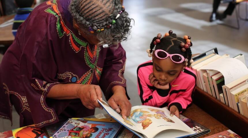 Woman and young girl looking at a book