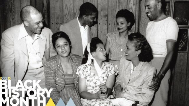 """Archived Teenie Harris photo of a group of adults with the text """"2020 Black History Month"""" positioned in the lower left hand corner."""