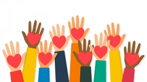 Array of multi racial raised hands with a heart in each palm.