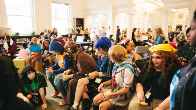 Teens in costumes celebrate their fandoms at the Library.