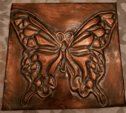 A high relief copper butterfly.