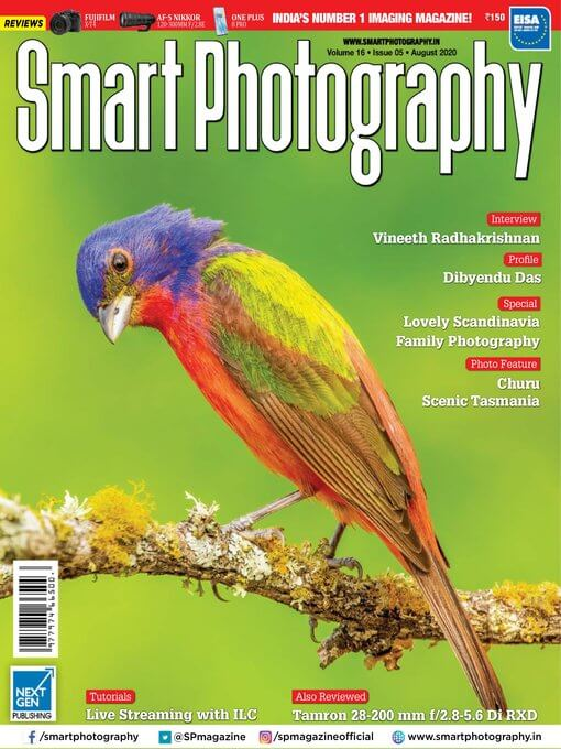 "Cover of the magazine ""Smart Photography"" shows a photo of a purple, green and red bird perched on a mossy branch."