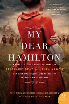 """The title, """"My Dear Hamilton"""" appears over a person in a red dress as they stand on a battle field."""