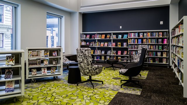 CLP - Downtown Teenspace with green carpet, bookshelves and retro style armchairs