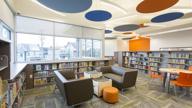 CLP - Mt. Washington Children's space with bright blue and orange disks hanging from ceiling