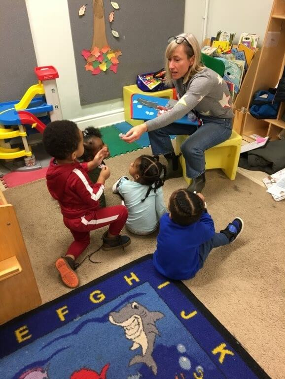 A library assistant uses a feltboard during a classroom storytime