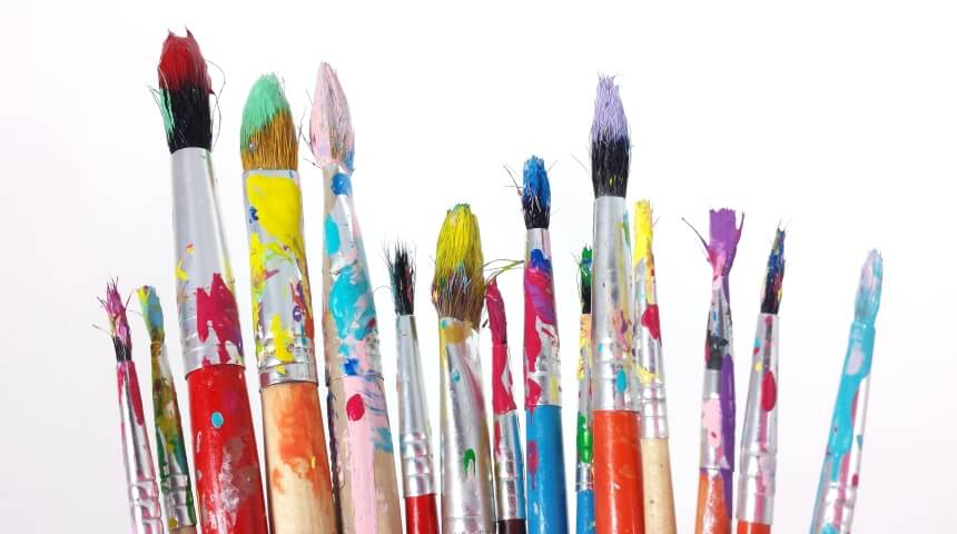 Collection of paintbrushes covered in wet paint
