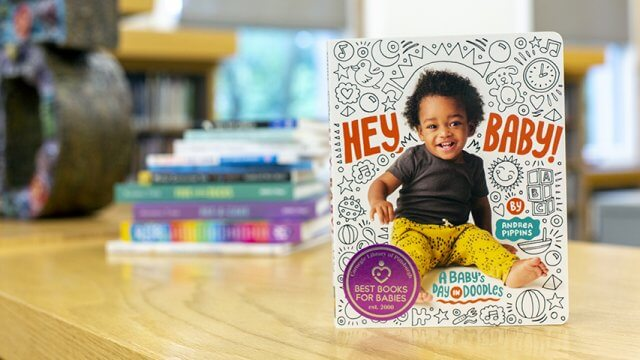 Hey Baby board book sitting in front of a stack of other Best Books for Babies books