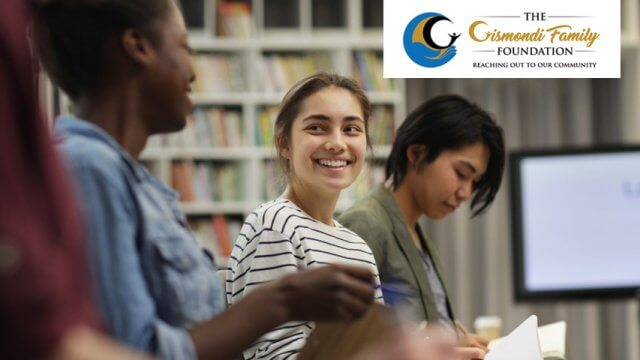 Three teens smiling and talking in the library with Gismondi Family Foundation logo in the upper right corner