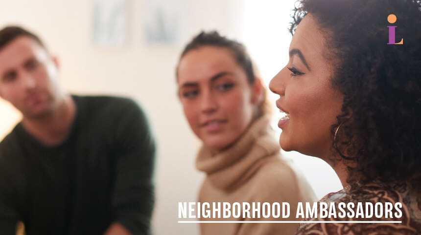 """Photo of two women and a man in conversation with the text: """"Neighborhood Ambassadors"""""""