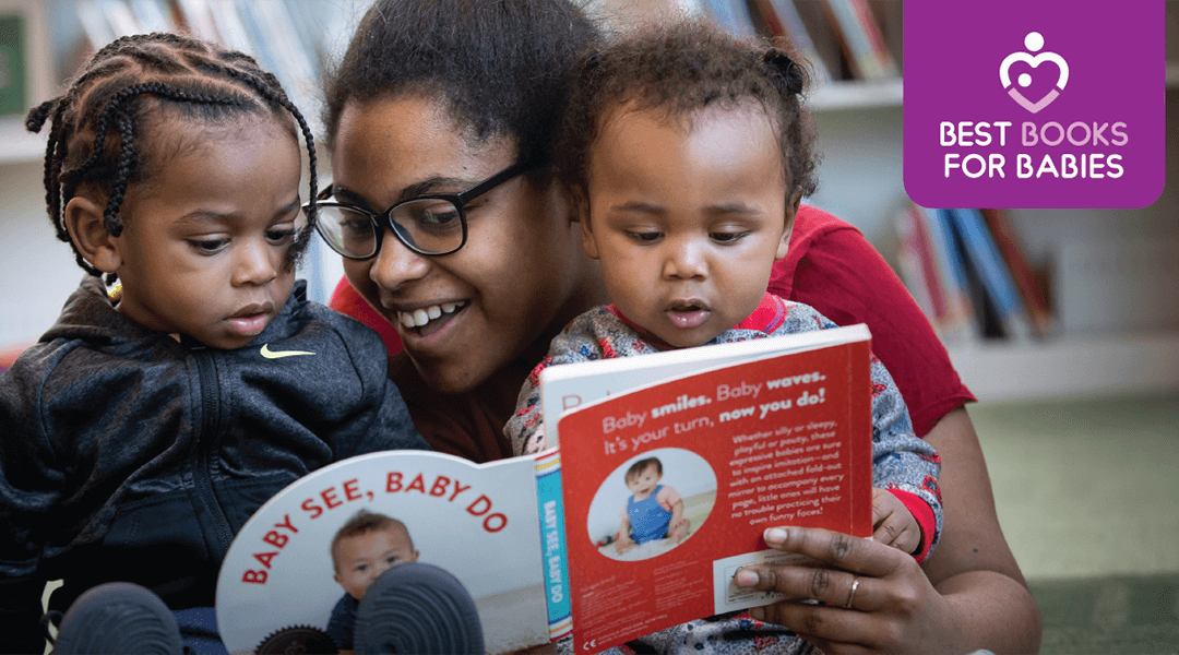 Mom and two toddler boys reading a board books