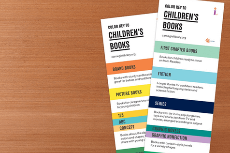 Two bookmarks showing a color key to identify different types of children's books