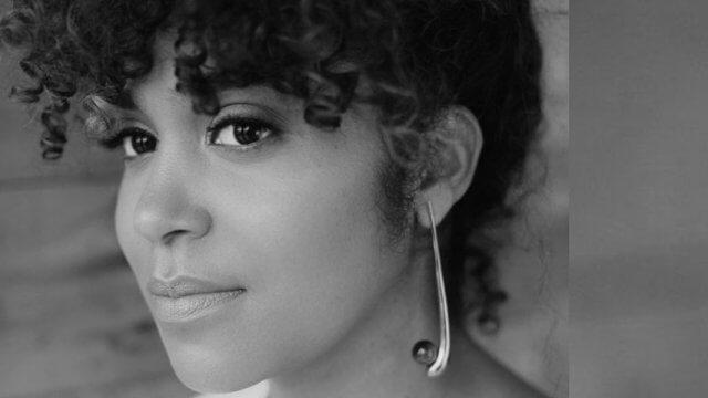 Black and white photo portrait of author Elizabeth Acevedo