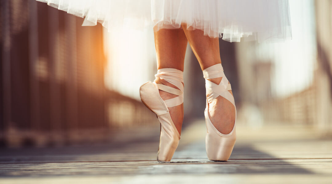 photograph of ballerina dances with focus on ballet slippers